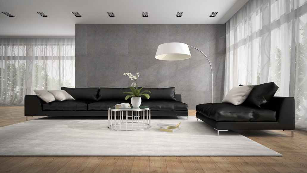 Wohnzimmer Im Italienischen Einrichtungsstil Mit Ledersofa In Schwarz
